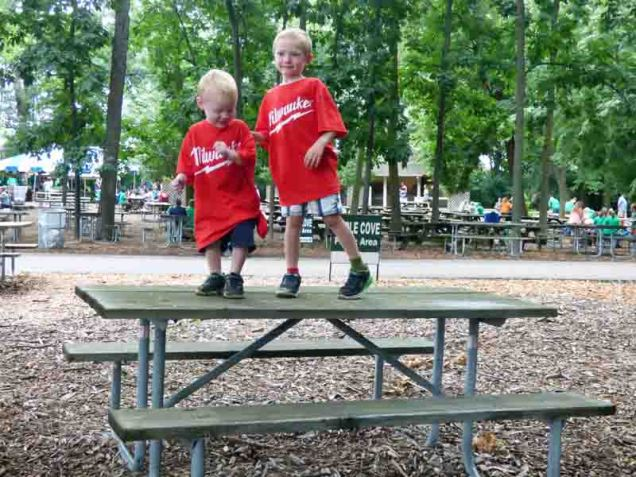 b Cam and Owen Dancing on the Picnic Table