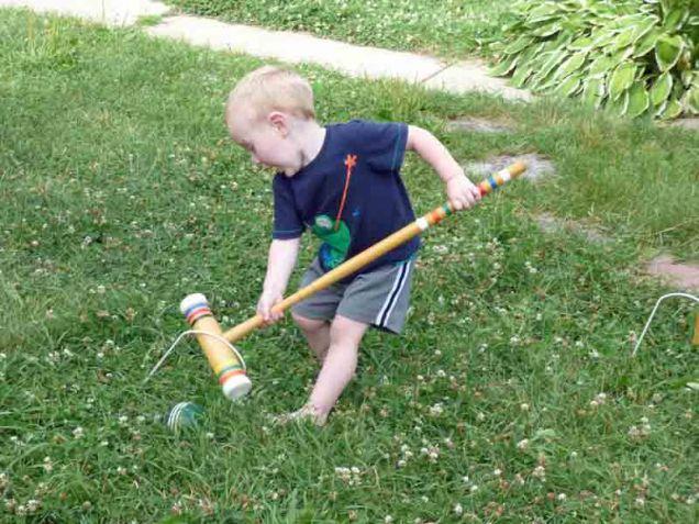 b Cam Playing Croquet