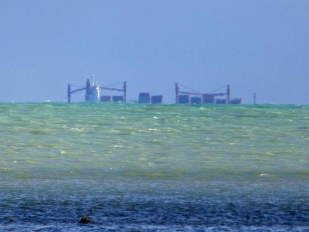 b-container-ship-over-horizon